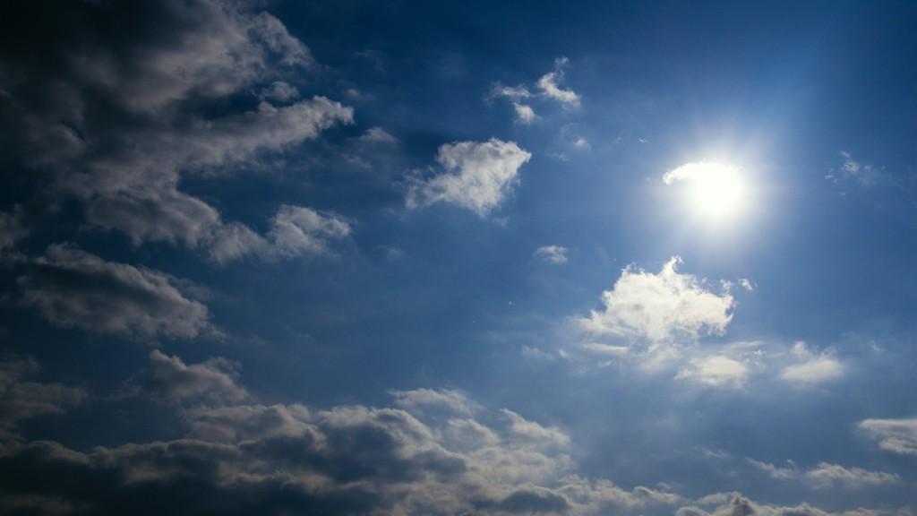 Timelapse sun and dark cloud
